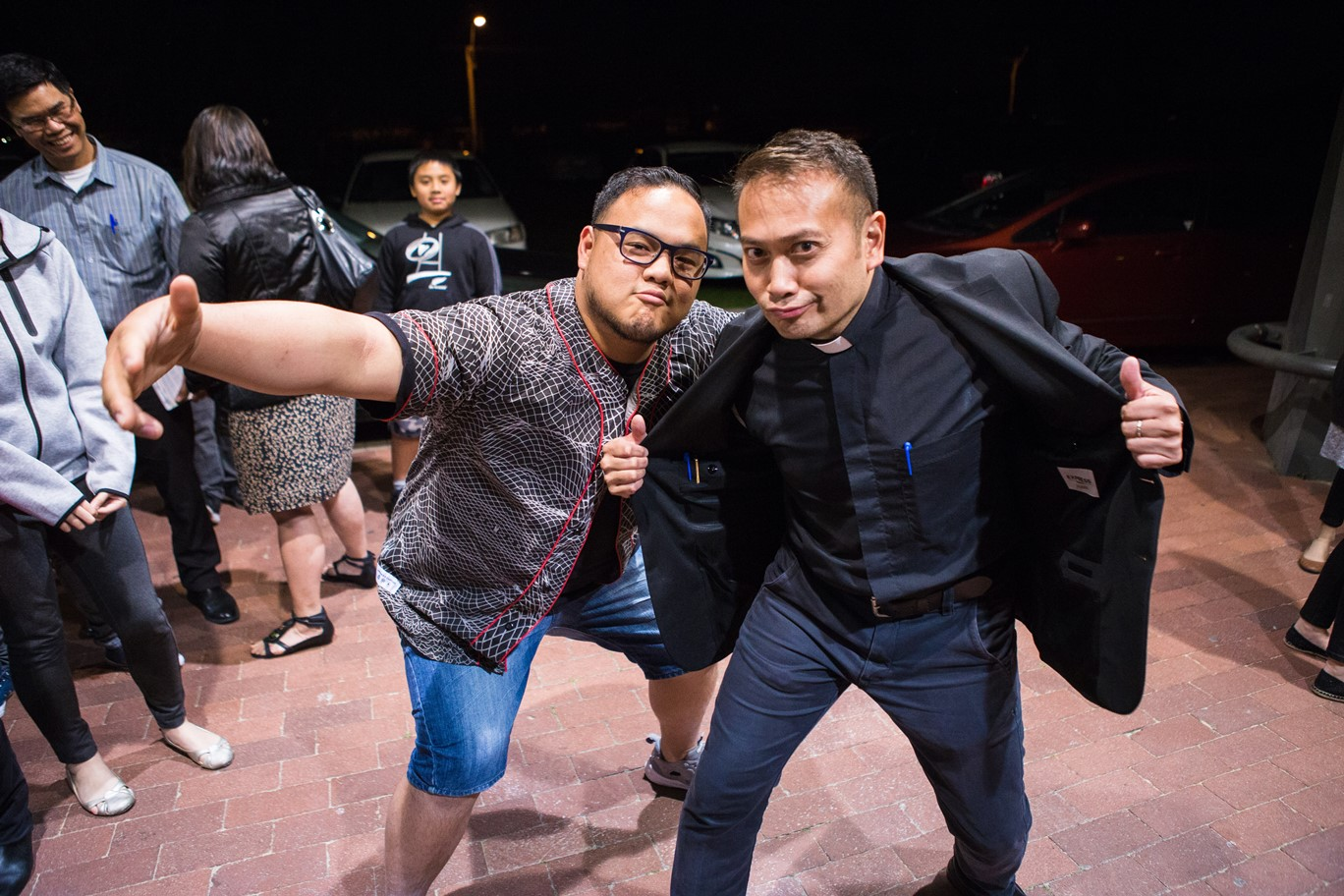 Fr. Leo and young adult take funny photos together